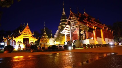 Wall Mural - Wat Phra Singh temple at night in Chiang Mai, Thailand.