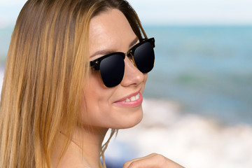 Head shot of woman wearing sunglasses