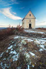 Small chapel on a hill in winter