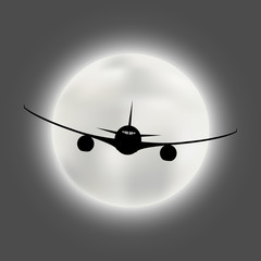 Silhouette of the aircraft on the background of the bright moon