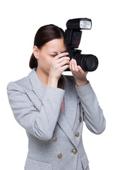 Asian Woman Photographer hold camera with external flash point to shoot subject, wear formal black suit. studio lighting white background isolated copy space, reporter journalist take photo celebrity