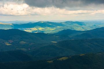 summer mountain scenery on an overcast day. distant ridge beneath in sunlight. beautiful landscape of carpathians