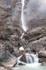 A close up of a large waterfall drop