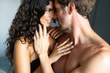 Beautiful passionate couple is having sex in bedroom