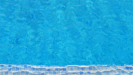 Swimming pool water background with texture of water surface with ripple effect, concept for summer vacation or spa, relaxation or working from anywhere, natural pattern with copy space