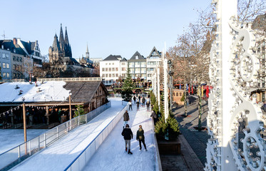Cologne, Germany - wintertime in the Old Town. In this fairy-tale atmosphere, a unique skating rink fits into the Heumarkt (Hay Market).