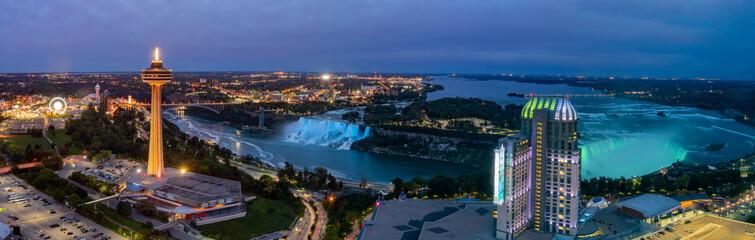 Night aerial view of the Skylon Tower and the beautiful Niagara Falls