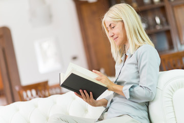 Mature woman reading a book