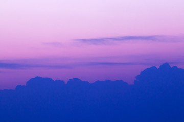 Beautiful purple-pink sky at sunset with a line of clouds