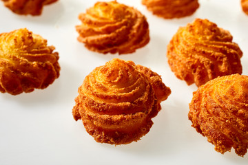 Gourmet fried potato cakes in twirled spirals Wall mural