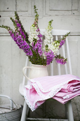 beautiful bouquet of field flowers - foxglove against the background of old white door