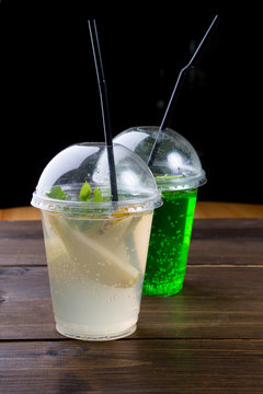 Soda lemonade drink in a plastic cup