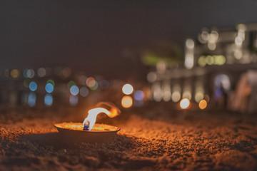 Candela con bokeh di Luci - Spiaggia - Amore