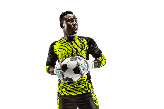 One african male soccer player goalkeeper standing and holding ball. Silhouette isolated on white studio background