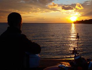 Biker watching the sunset