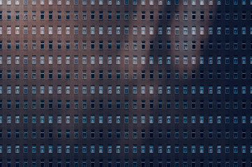 architectural pattern, reflected light on a facade of a miserable house