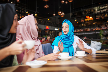 Muslims are having fun at a coffee shop