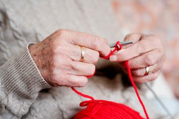 old caucasian woman knitting