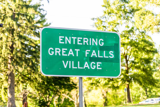 Great Falls, USA sign for downtown in Northern Virginia city town with closeup in Fairfax county and green trees in background