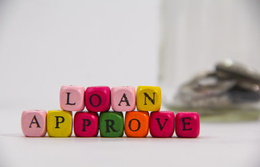 Loan Approve with colourful alphabet on white background.