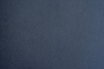 Colored paper background texture. Dark grey seamless pattern