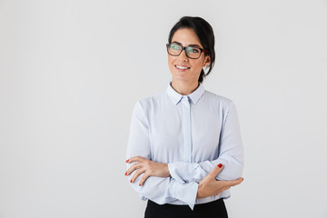 Photo of caucasian businesswoman wearing eyeglasses standing in the office, isolated over white background