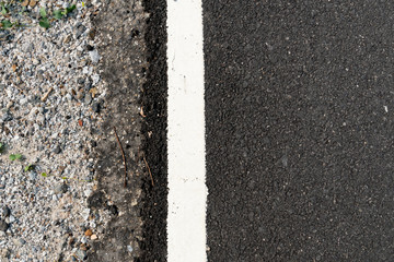 Asphalt road side corners with white border lines