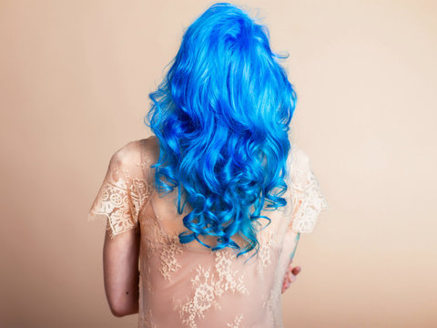 blue hair hairstyle curls girl's back bright hair color creative painting in a bright shade colorist work summer style