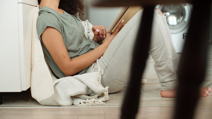 Pretty young woman using digital tablet at home.