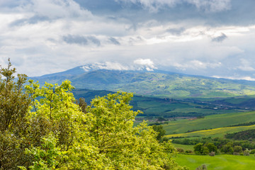 Beautiful landscape view in Tuscany with storm clouds and a mountain