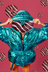 Abstract contemporary art. A woman's body with donut head on red background