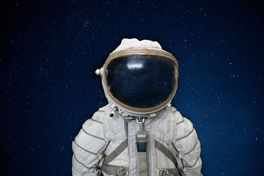 Soviet cosmonaut or astronaut or spaceman suit and helmet on black space with stars background