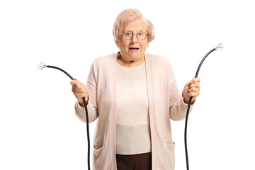 Confused old lady holding a broken cable