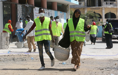 Construction workers are seen as they take part in the renovation project of Somalia's National Theatre in Mogadishu