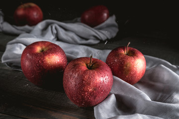 Fresh red apples on wooden table