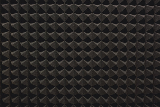 Strong protection from loud music. Close up view of a grey soundproof coverage for a recording studio