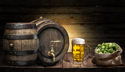 Wall Mural - Beer mug and small keg of beer on the wooden table. Craft brewery.