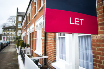 'To Let' estate agent sign on residential street