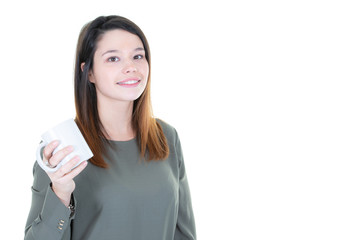 young woman with cup mug of coffee looks side copyspace