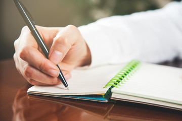 woman hand pen with notepad