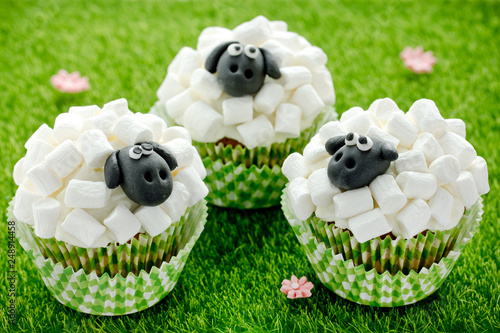 Easter Sheep Cupcakes On Green Grass Background Homemade Cup Cakes Shaped Funny Sheeps With Marshmallow And Black Fondant Icing Faces Creative Treats For