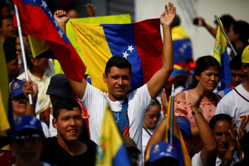A man holds a Venezuelan flag as he takes part in a rally to commemorate the Day of the Youth and to protest against Venezuelan President Nicolas Maduro's government in Urena
