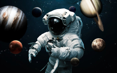 Fond de hotte en verre imprimé Univers Astronaut and all planets of Solar system. Science fiction art. Elements of this image furnished by NASA