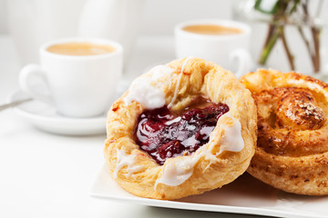 Breakfast setup with Danish pastries and coffee Fototapete