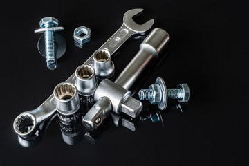 Screws, washers, nuts, keys for loosening and tightening