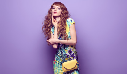 Fashion gorgeous woman in spring summer Trendy outfit, glamour makeup, accessories. Portrait long-haired sexy fashionable model girl posing in Studio on purple, banner