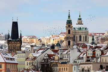 Snowy Prague Lesser Town with St. Nicholas' Cathedral, Czech republic