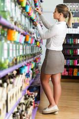 girl choosing new perfume