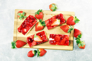Wall Mural - strawberry cake and many fresh strawberries on grey background table