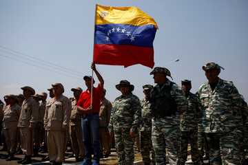 Venezuelan militia members stand in formation during a gathering at the entrance of the Tienditas cross-border bridge between Colombia and Venezuela in Tienditas